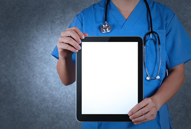 Doctor working with tablet computer