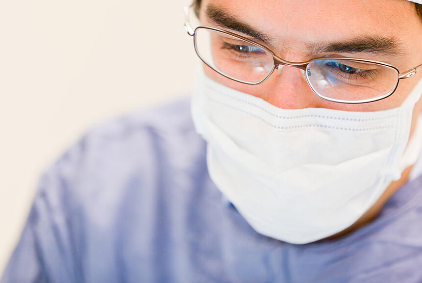 Male doctor operating in the surgery room
