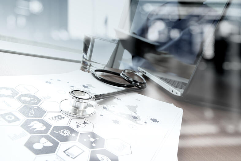 double exposure of doctor working with digital tablet and laptop computer in medical workspace office and medical network media diagram as concept